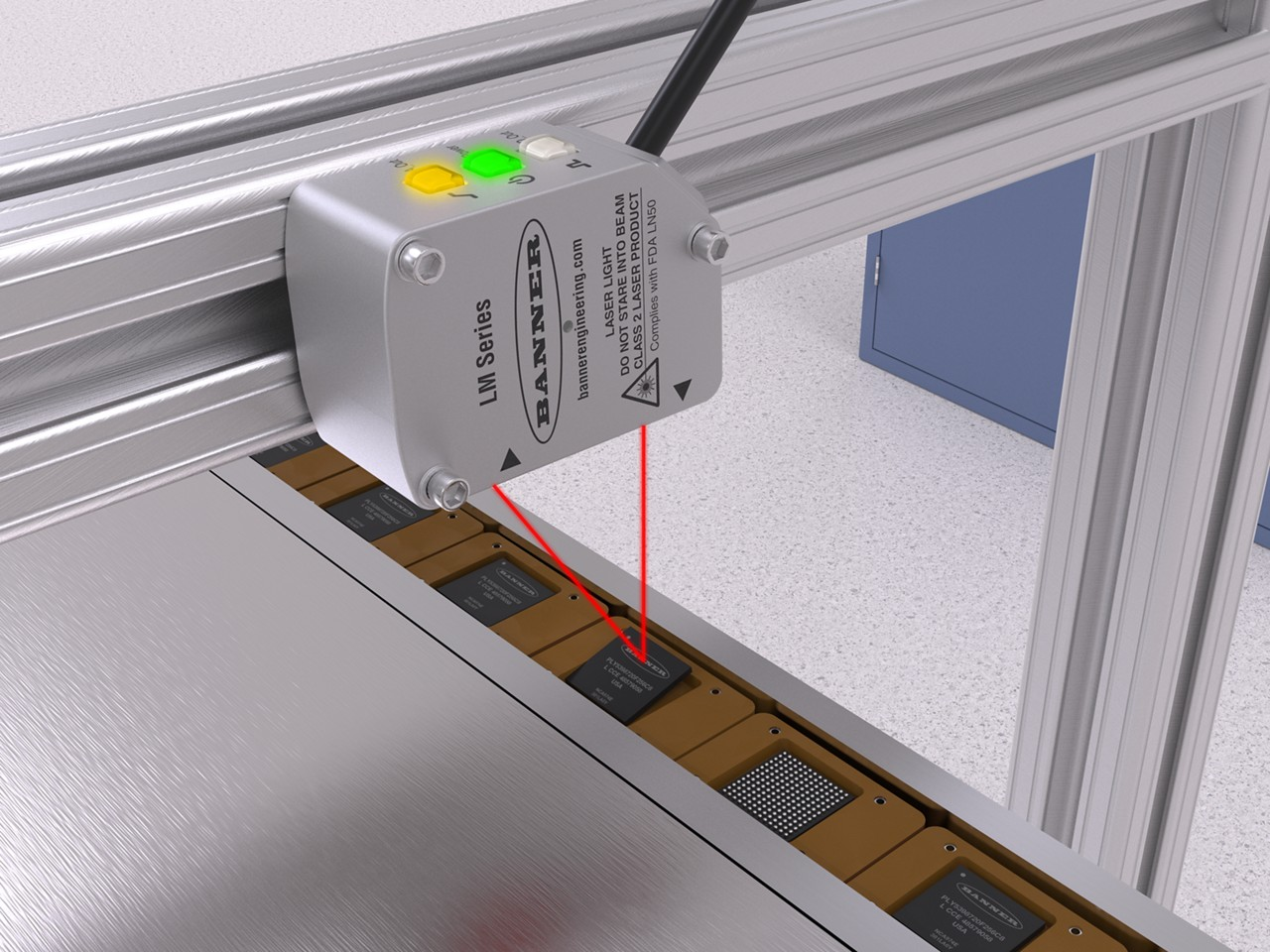 LM precision measurement sensor inspects IC chips seated in nests