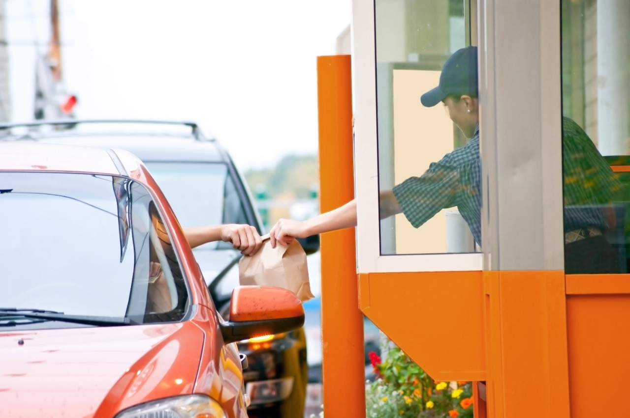 fast food drive thru window in orange for success story