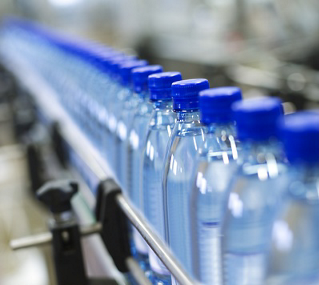 Consistent Detection of Transparent Plastic Bottles Along a Conveyor Machine [Success Story]